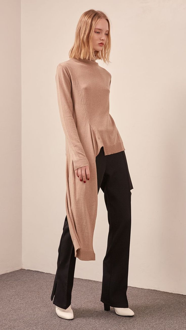 The Theron Knit in Beige. Features lightweight turtleneck with asymmetric hem, long sleeves. Pull on. COMPOSITION AND CARE Dry clean only Please treat with care to extend the life of your cloth Updati