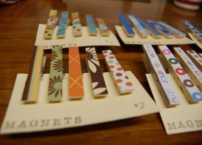 Clothespins + Scrapbook Paper + Decoupage = really cute custom clothespins for your craft studio or to give as gifts. Add a magnet and they would be adorable to clip the kids artwork on the fridge. #scrapbooking #diy #crafting