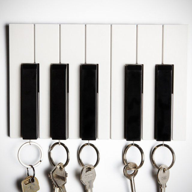 The #Piano #Key #Organizer is a place for you to hang your keys up on what looks like a bunch of piano keys. It's a wicked combination of form and function. Five piano keys are used to hold the real keys, and a press of the piano key is required to put in or extract a real key. http://thegadgetflow.com/portfolio/piano-key-organizer/
