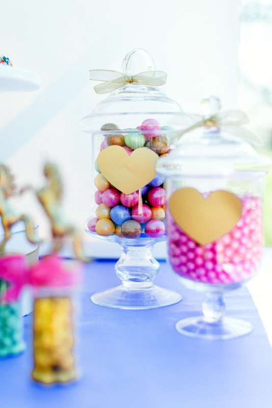 Unicorns, hearts, and  rainbows birthday party candy jars! See more party ideas at CatchMyParty.com!