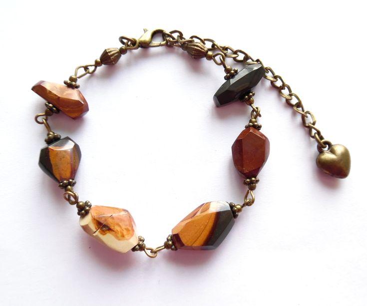 Armband i brons med facetterade pärlor av wonderstone.  Storlek: 18,5-25cm