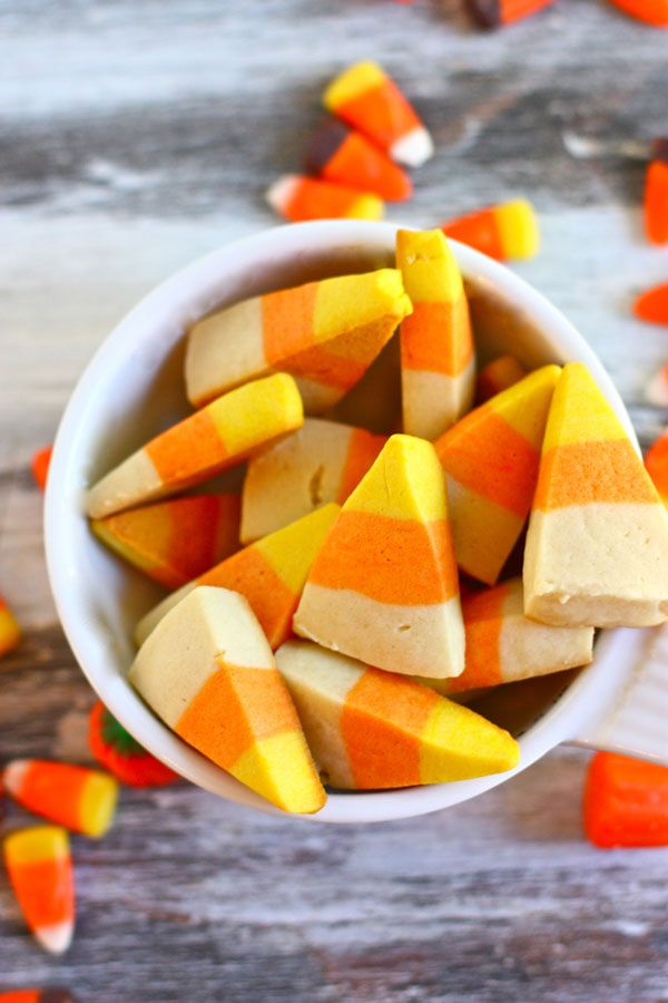 How to turn basic sugar cookies into candy corn cookies. Great recipe idea for Halloween!