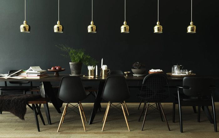 Stunning black contemporary dining room with gold accents