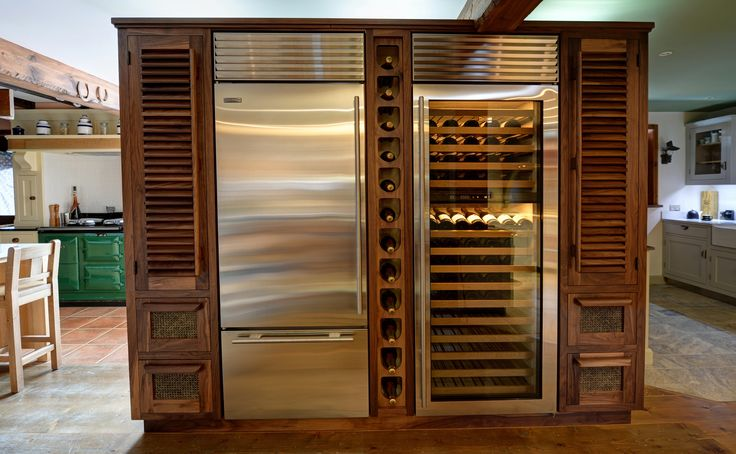 American Black Walnut drinks storage cabinet with SubZero Refrigeration and wine store. This is perfect for the storage of wine, Champagne, beers and spirits with plenty of space for glassware and all the necessary paraphernalia in the cupboards.