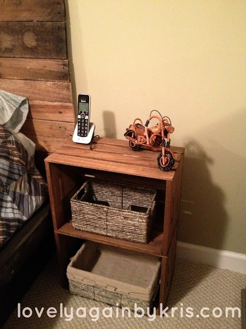 DIY nightstands. JoAnn's unfinished apple crates and two baskets // just use one basket (with a lid), leaving the upper shelf open. Can also find these at Michael's.