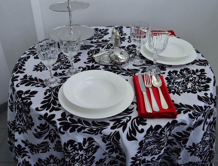 White/Black Flocked Table Linen, Studio White China, Regency Flatware, Empire Crystal Glassware, Stainless Steel Butter Dish, Crystal Salt & Pepper, 3 tier Stainless Steel Stand & Rouge Satin Napkin  Chair-man Mills