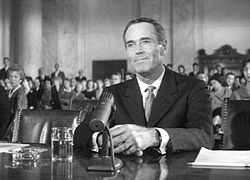 Secretary of State nominee Robert A. Leffingwell (Henry Fonda) appears before the Senate Committee, in Advise and Consent.