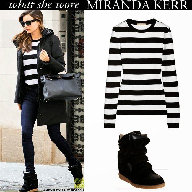 Miranda Kerr in black and white stripe sweaeter, black jacket, blue jeans with black suede wedge sneakers