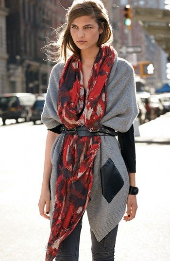 Street fashion belted scarf and sweater.