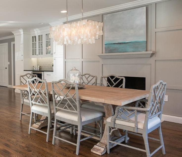 Hanging Capiz Chandelier Illuminating A Salvaged Wood Trestle Dining Table Lined With Gray Bamboo Chairs Ballard Designs Dayna Arm