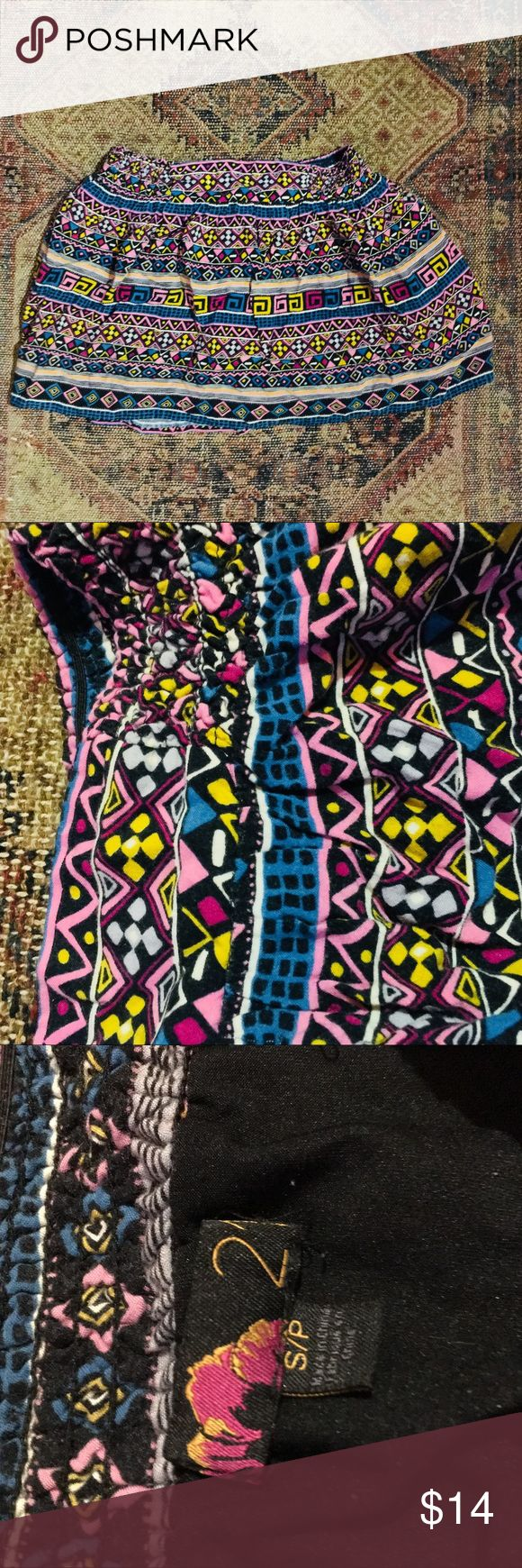 Tribal print skirt This comfortable and fun flashy skirt has been my favorite but it's time to clean the closet for the new so I must say goodbye. The waist is stretchy but it doesn't fall down. Tag says small fits small or medium. Charlotte Russe Skirts Mini