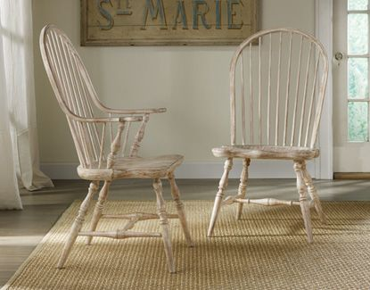 I have a pair of golden oak windsor chairs, painting them would update the look. Maybe staining because paint would be hard to get between each spindle @somersetbayhome.com
