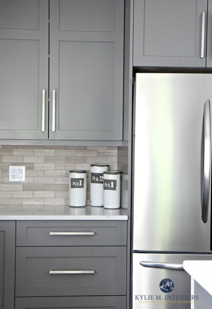 Benjamin Moore Amherst Gray painted cabinets, driftwood backspash in subway tile layout. Kylie M Interiors E-design