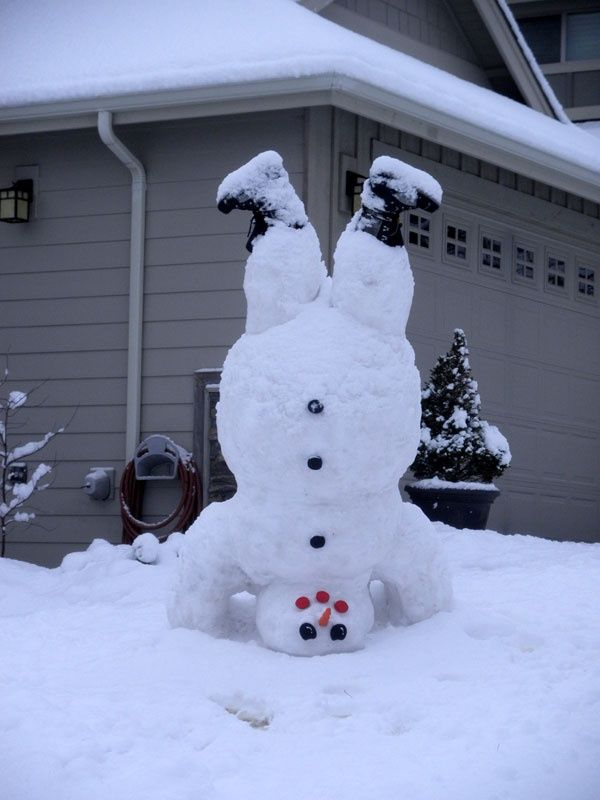 Upside down snowman with boots makes me smile