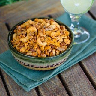 cashews, walnuts, almonds baked in garlic infused olive oil, smoked salt, and smoked paprika -- looks delicious! Paleo Snack Mix   Cook Eat Paleo