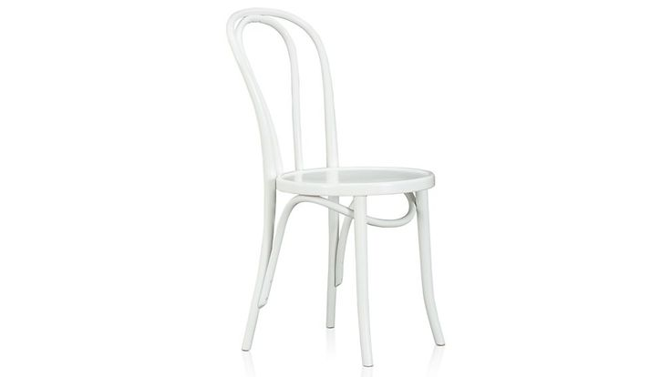 Shop Vienna White Wood Dining Chair and Cushion.   This timeless, curvy classic is both incredibly strong and light, making it a popular choice for bistros and cafes.  A white lacquer finish gives it crisp versatility.