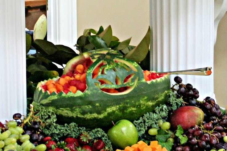 My dad carved this watermelon basket with bells on the handles for my in-laws 50th Wedding Anniversary reception.