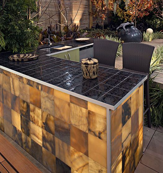 Outdoor kitchen with an onyx backlit feature. Design and installed by Stone 101.