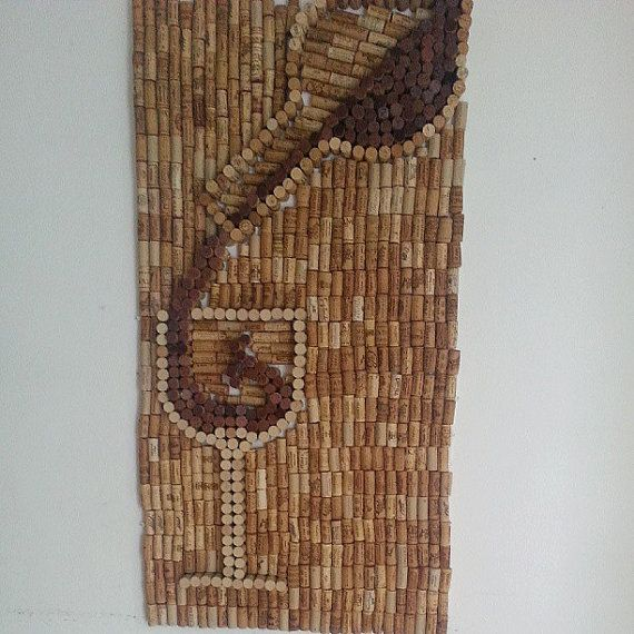 Made up of over 800 real corks created into a mural of a wine bottle pouring red wine into a glass. The corks are securely glued to a board so it is