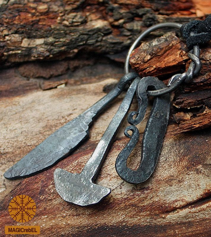 This is a forged iron handmade Viking style pendant. The pendant is a mini replica of a Nordic hunting tool set which ancient Vikings carried with them: a knife, a hammer (Thor's hammer) and a fire striker. Style is unisex, looks good on both men and women.  #magicrebel #forged #iron #handmade #vikings #knife #hammer #fire #striker #tool #set #pendant #necklace #larp #jewelry