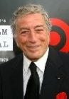"Tony Bennett. In 1949, Bennett was invited on a concert tour by Bob Hope, who suggested him to use the name Tony Bennett. He was born Anthony (Antonio) Dominick Benedetto on August 3, 1926. He changed his stage name from ""Joe Bari"" to ""Tony Bennett."""