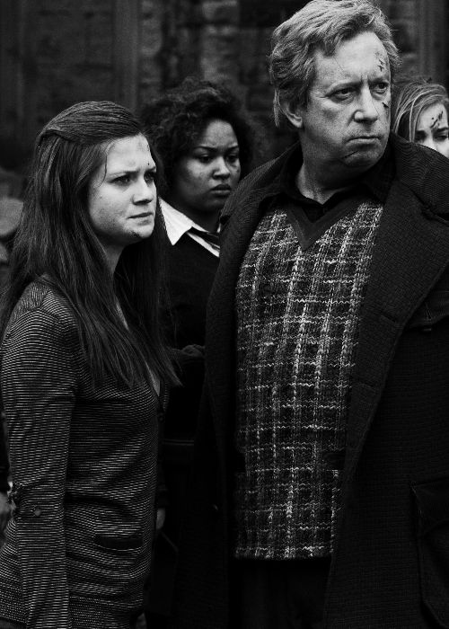 This scene is so frickin sad because Ginny is seeing her boyfriend's dead body, who she had always loved, and her dad is looking at the boy who's saved half of his family's lives. INCLUDING HIS OWN. But they have to be calm. You just know they both wanna breakdown and cry. I DO TOO