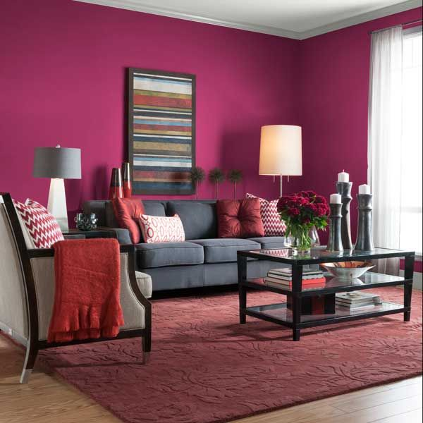 This inviting setup stays stylish with pops of red accents and purple-red walls. | Very Berry (R01), @gliddenpaint