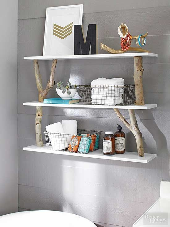 Skip the department store. Instead, add a little sizzle to your bathroom shelves with supplies from the crafts store. Spray-paint an unfinished wood letter in black before covering the edges with golden glitter washi tape. Use the same tape to make a chevron or geometric design, then dress it up with a white mat and frame./