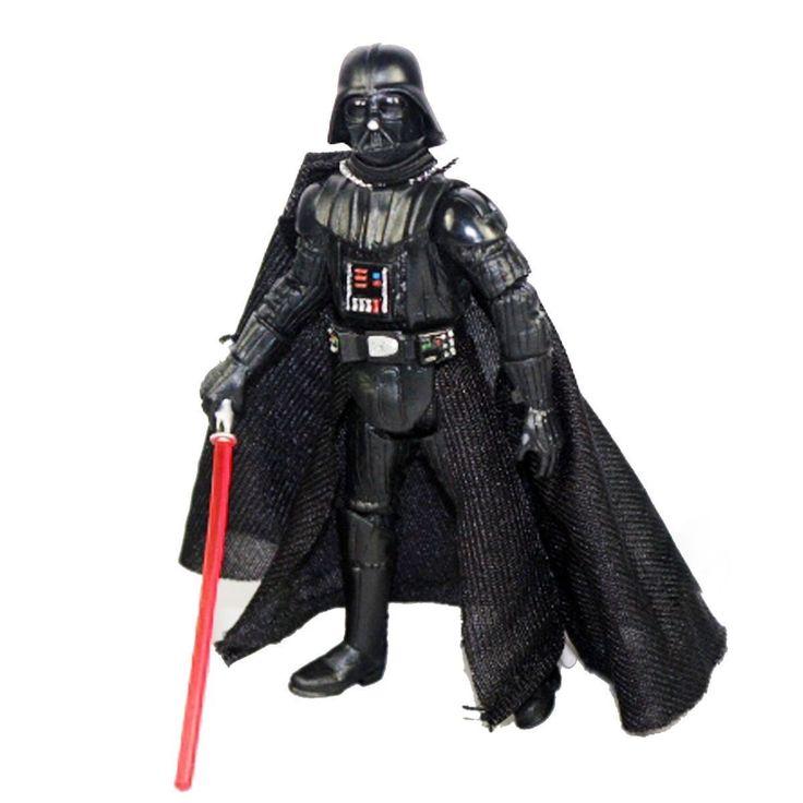 Muñeco articulado de Darth Vader, con sable de luz y capa. Aprox. 10 cms. de…