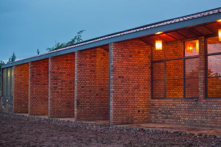 Gallery of Partners In Health Dormitory / Sharon Davis Design - 18