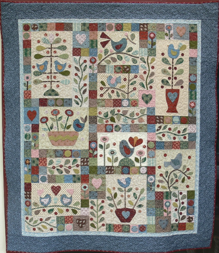 Bluebirds and berries, a lovely finished quilt, design by Gail Pan Designs