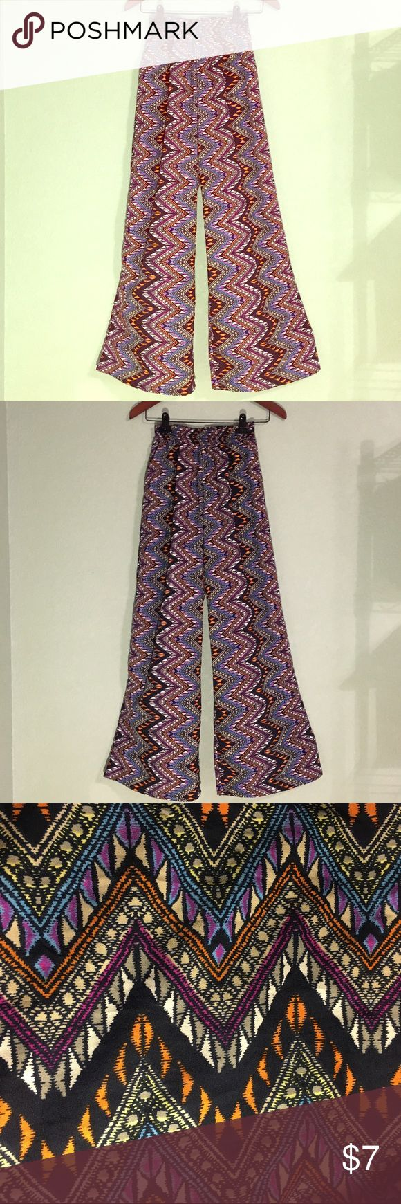 """Charlotte Russe Wide Leg Tribal Print Pants Charlotte Russe Wide Leg Tribal Print Pants ~ Elastic Waist ~ X-Small ~ Inseam is approximately 30"""" ~ 100% Polyester Charlotte Russe Pants Wide Leg"""