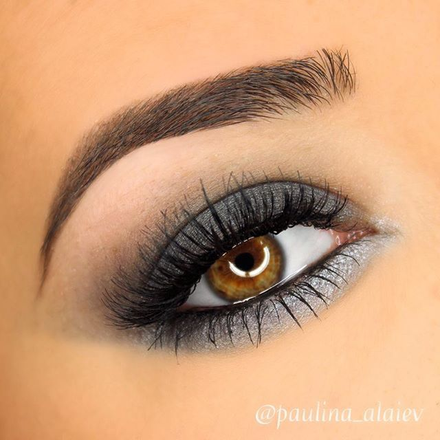 Dark gray smokey eye BROWS: @anastasiabeverlyhills dipbrow pomade in 'dark brown' EYES: @makeupgeekcosmetics eyeshadow in 'stealth' through my crease, 'galaxy' on my lid and outer half of my lower lash line, and @makeupgeekcosmetics foiled shadow in 'highwire' on my inner lower lash line. @ardell_lashes in double up 204
