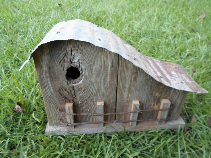 The Curvy Bird. I can see this birdhouse nestled into greenery on a tree branch or fence top.