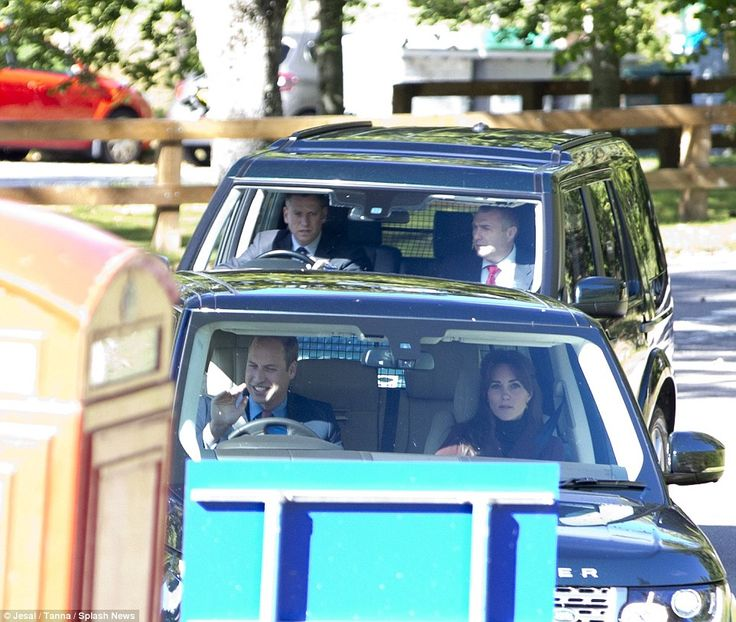 A cheery Prince William waved at wellwishers as he drove his car into the local church...