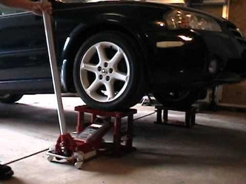 MY Lift Stand Inc  With a few mods this very good idea could be a bit better. Example: Paw & Ratchet  in tubes (like jack stands) and a drop in ramp for backing car off so you dont need to Jack it off :)