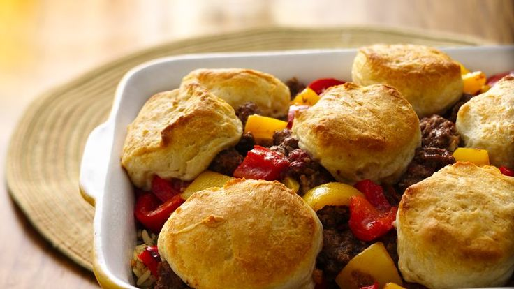 Treat your family to a hearty dinner with this spicy casserole that features beef, Muir Glen® tomatoes, Pillsbury® Grands!® Jr. Golden Layers® biscuits, rice and bell peppers.