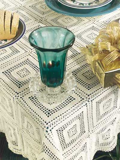 Crochet this lovely square-motif tablecloth to use at all those special family dinners. Free Crochet Pattern