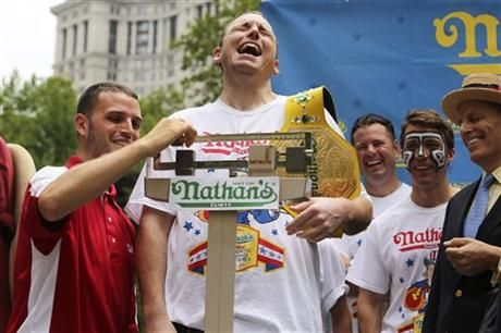 Joey Chestnut downed 69 franks to break record and win 7th straight hot dog eating contest in New York. (via @The Associated Press)