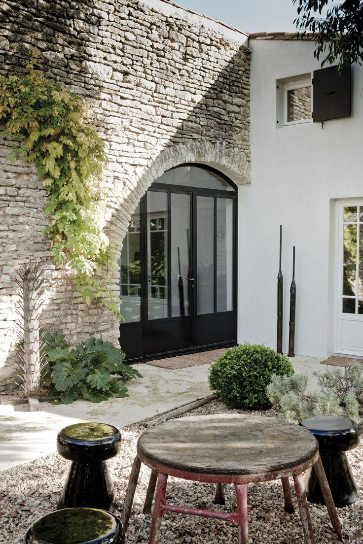 old stone arch + modern doors/windows