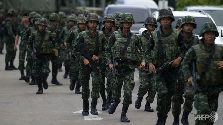 Thai soldiers patrol after army chief Prayut Chan-O-Cha met with anti-government and pro-government leaders at the Army Club in Bangkok. (AFP/Pornchai Kittiwongsakul) ▼22May2014ChannelNewsAsia|Thai army orders all radio and TV to suspend normal programmes http://cna.asia/1lGxZoY #Thailand_soldiers