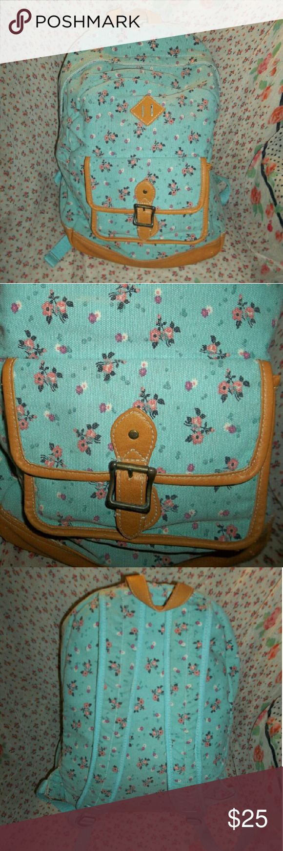 🆕 Floral Blue Backpack 🆕 Floral Blue Backpack  Pattern:  floral Colors:  robin egg blue with tan lining Tan lining is faux leather Medium-sized compartment on the front 4 more compartments on the inside, varying in sizes Good sized backpack, can fit a lot in it New, but without the tags  **MAKE ME AN OFFER IF INTERESTED** Pb teen Bags Backpacks