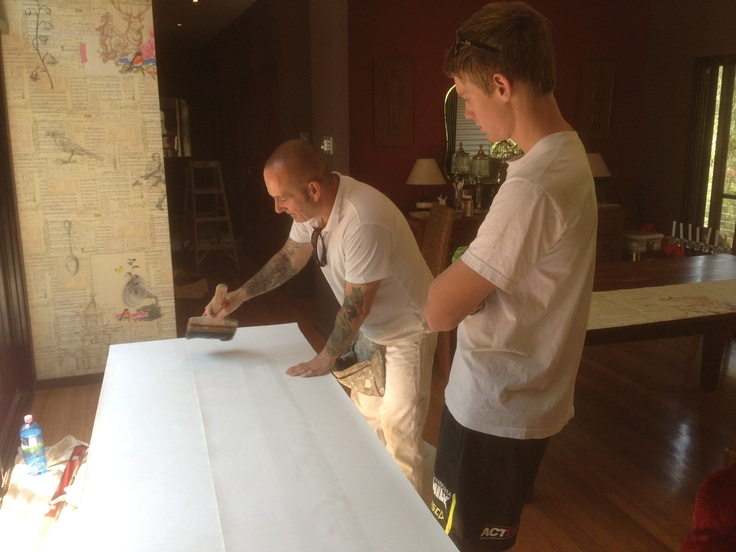 Our apprentice wallpaper hanger, David, learning the ropes!