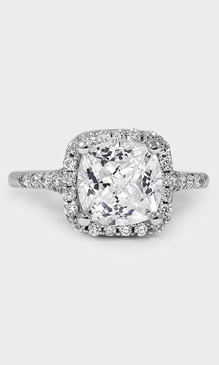 An amazing 3 carat cushion diamond shines at the center of the Harmony Diamond Ring.