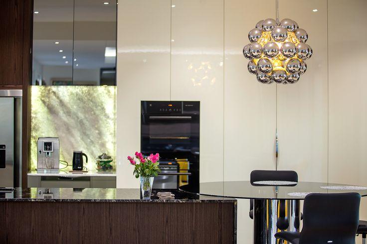 luxury kitchen, titanium granite, gloss 2 pack, designer kitchen, vzug, vintec, mirror doors, dark timber, back lit onyx, minka joinery