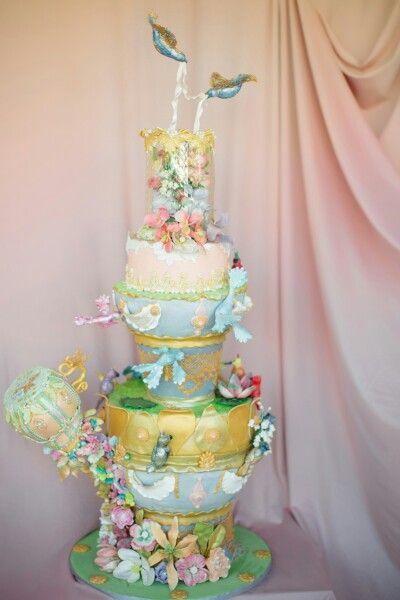Baroque bird fountain defying gravity cake