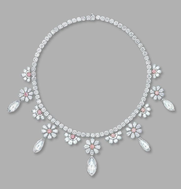 An elegant pink diamond and diamond necklace