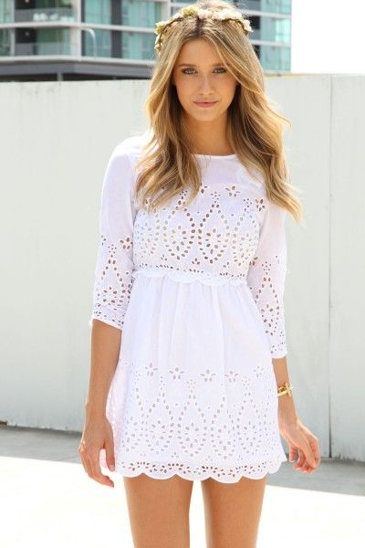 $52.00. Insanely cute white dress featuring cutout eyelet and embroidered detailing throughout.