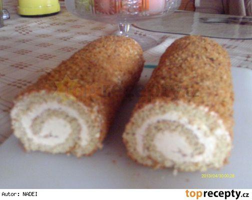 Medovníková roláda 4 vejce (4 bílky + 3 žloutky) 100 g práškového cukru 2 PL medu 120 g polohrubé mouky 1 KL prášku do pečiva 1 KL perníkového koření na krém: 1 máslo 1 karamelové salko 300 ml mléka 1 karamelový pudinkový prášek na obalení: cca 50 g směsi strouhaného perníku a mletých ořechů