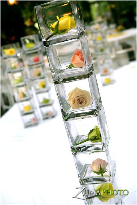 simple arrangements, rose buds for your wedding reception